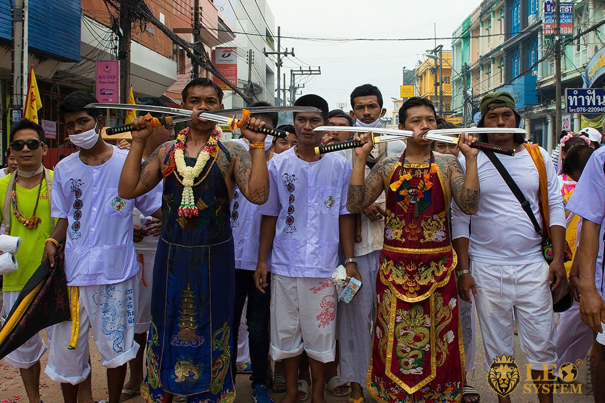 Phuket Vegetarian festival 2019 - Nine Emperor Gods religious ritual ceremony of body piercing mutilation with swords sharp object crackers