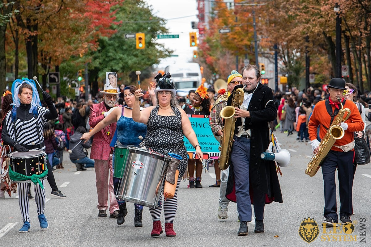 Vancouver, Canada - People go with drums and saxophones - Halloween street parade 2019