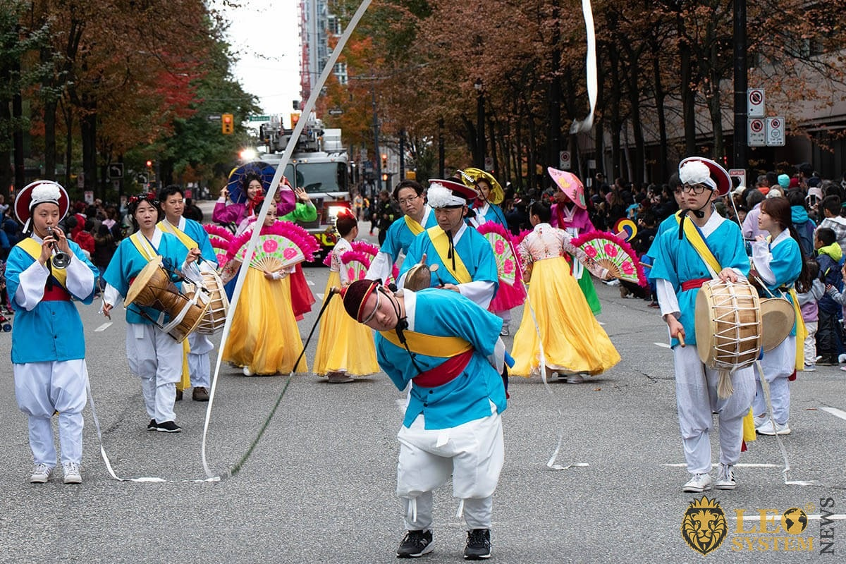 Vancouver, Canada - People go with drums and pipes - Halloween street parade 2019