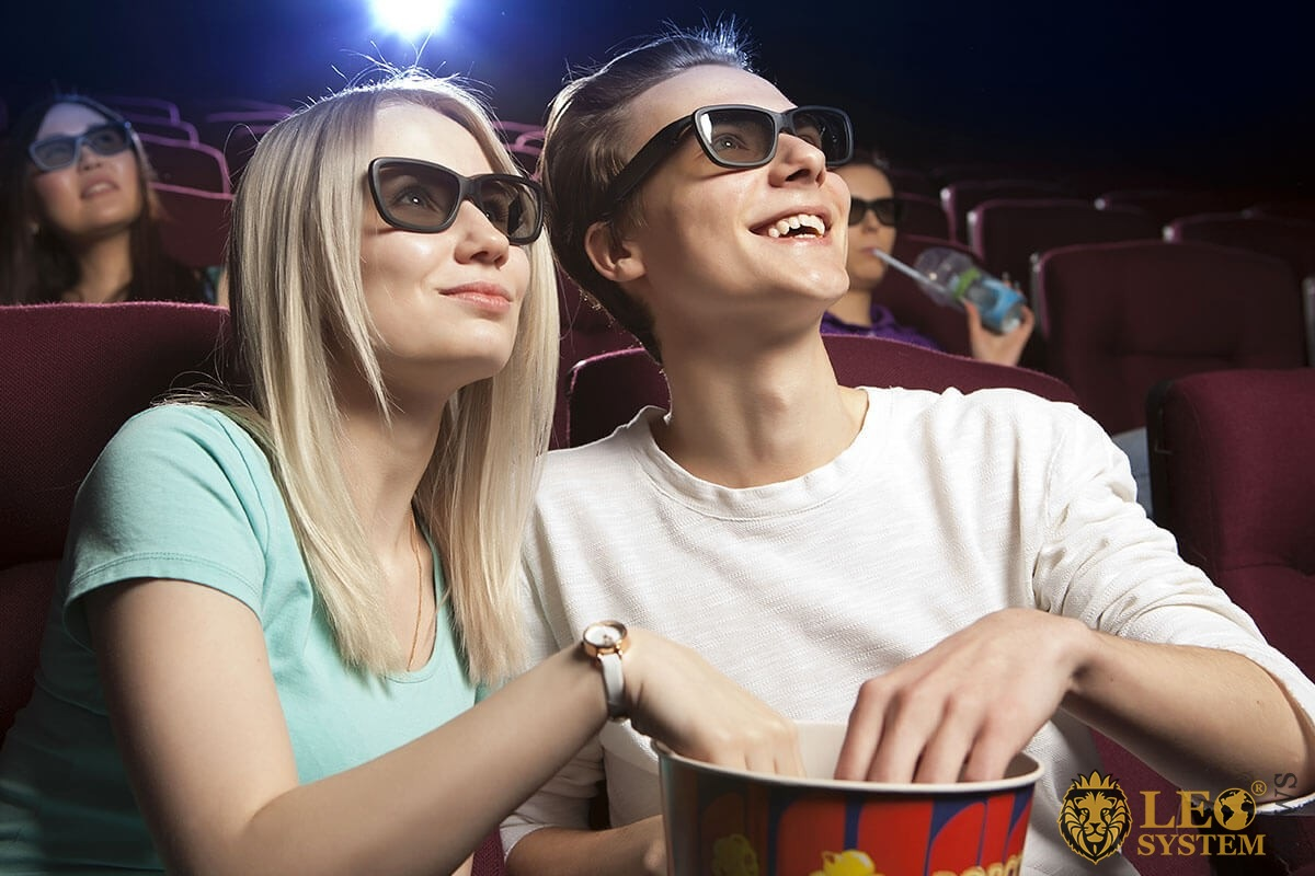 Male and female watching a movie together