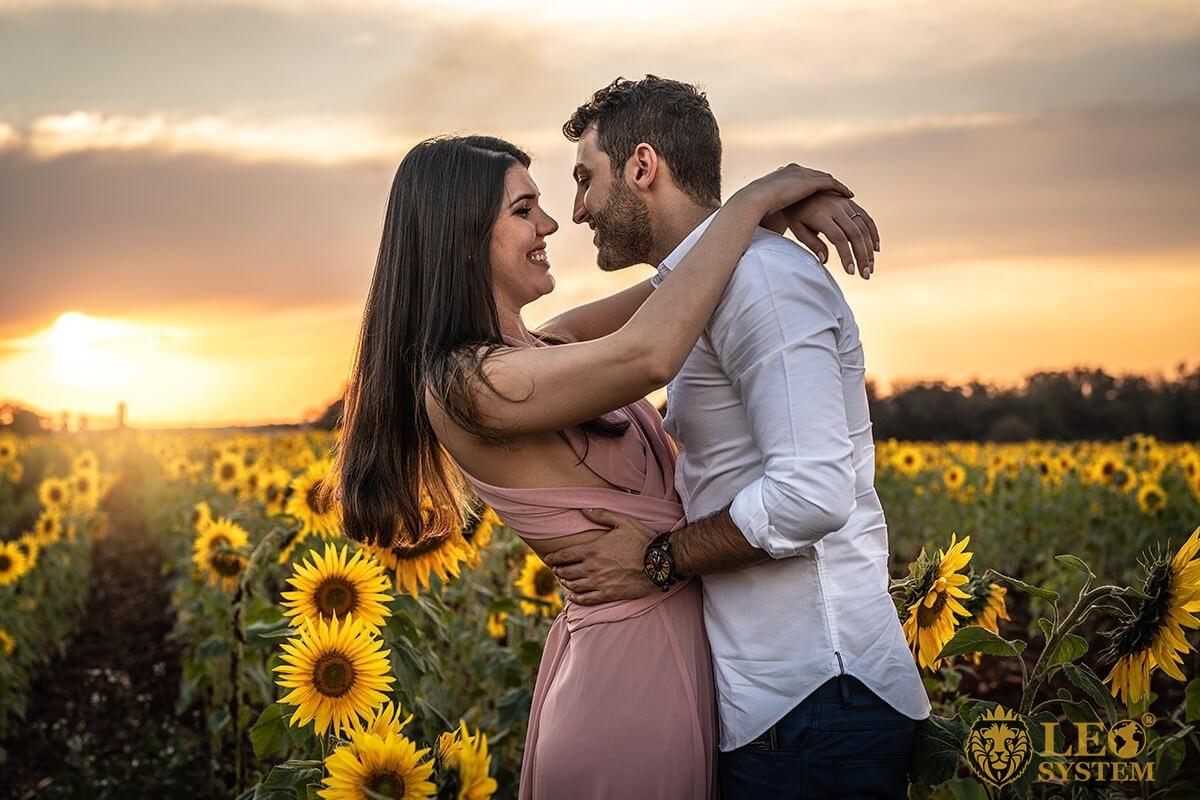 Loving couple hugging at sunset
