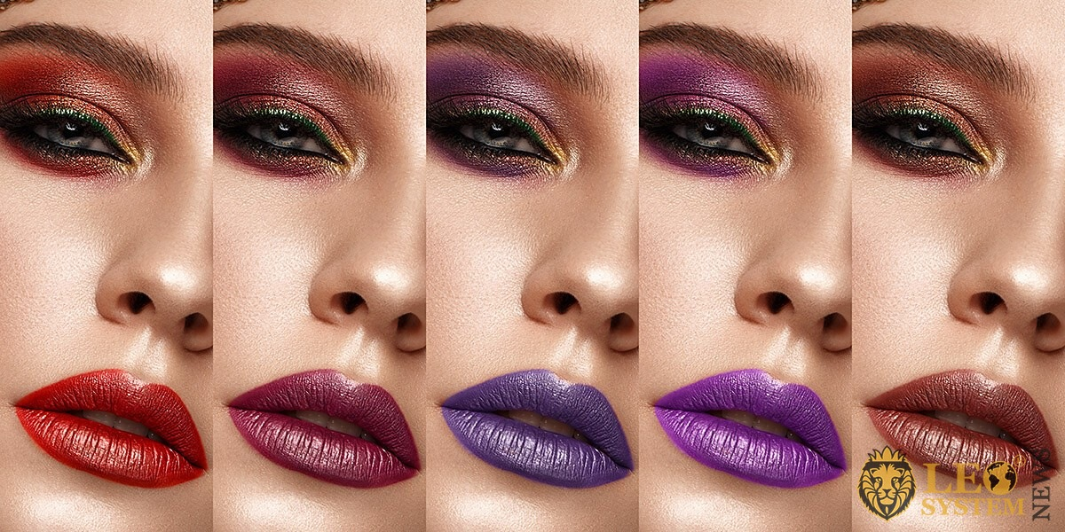 Woman with various options for applying makeup on her lips