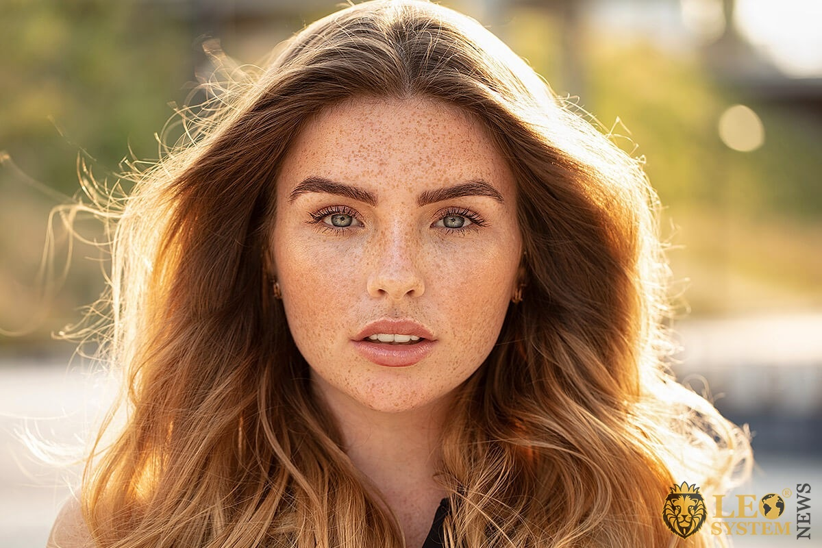 Beautiful girl with many freckles on her face