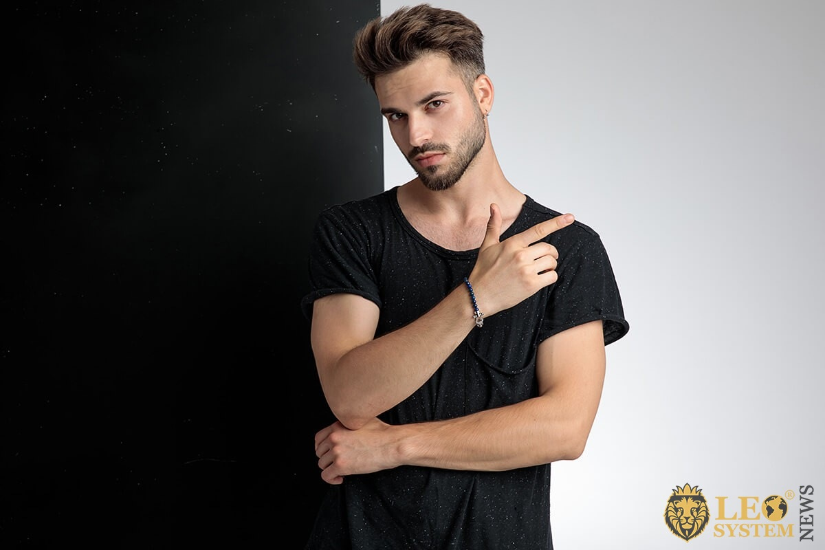 Charismatic young guy on a black white background