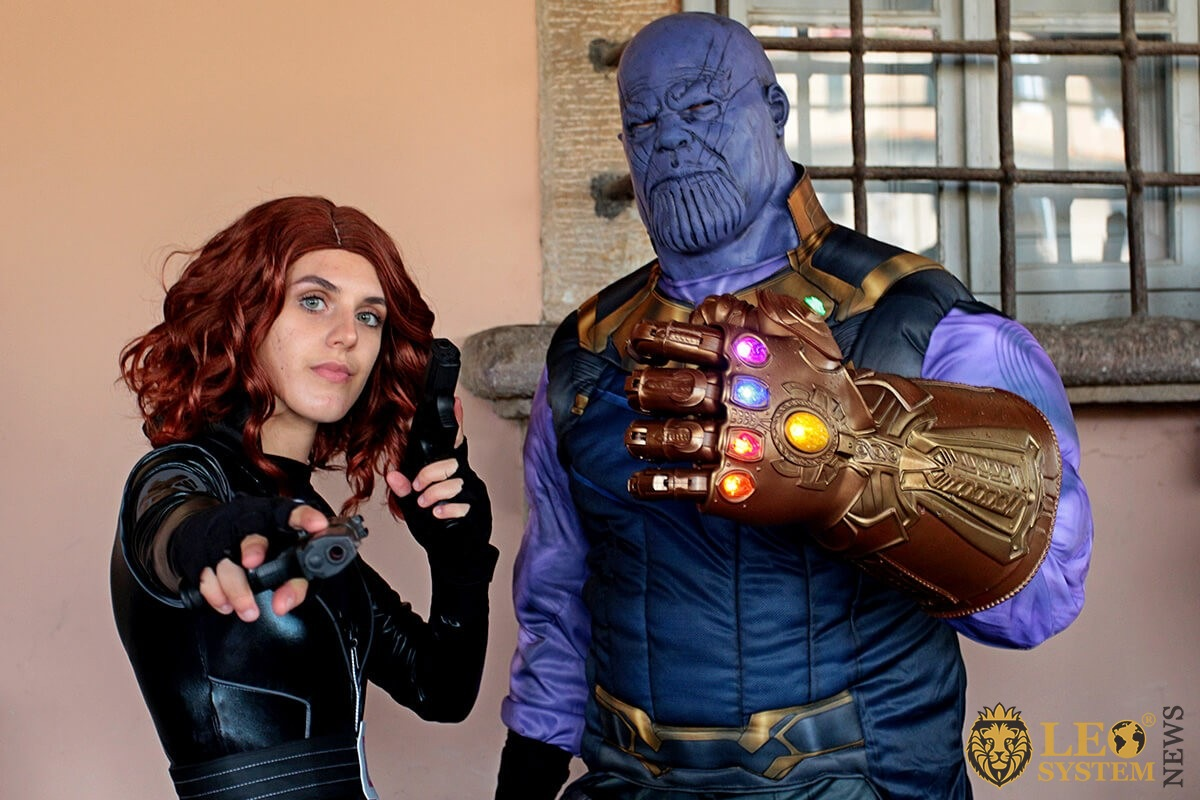 Two cosplay disguised as Black Widow and Thanos of the Avenger superheroes of Marvel - Event Lucca Comics & Games
