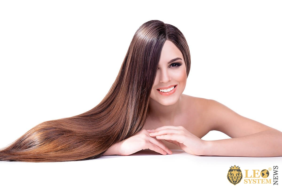Woman shows long and well-groomed hair