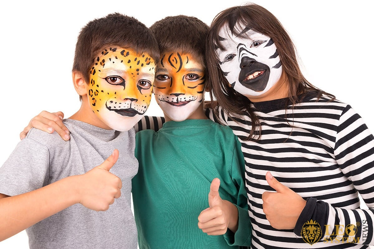 Children with painted faces in the form of animals
