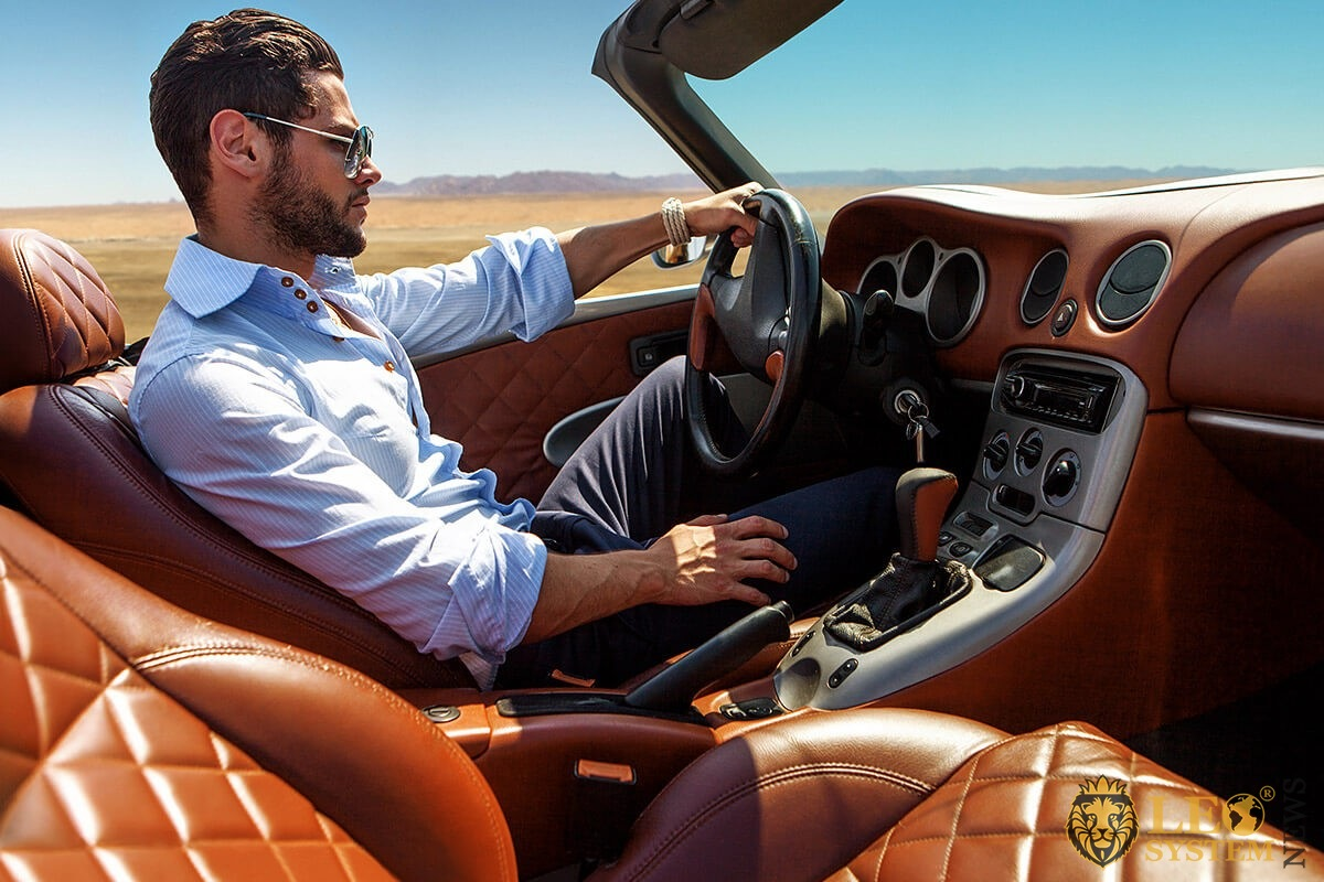 Wealthy guy driving an expensive convertible