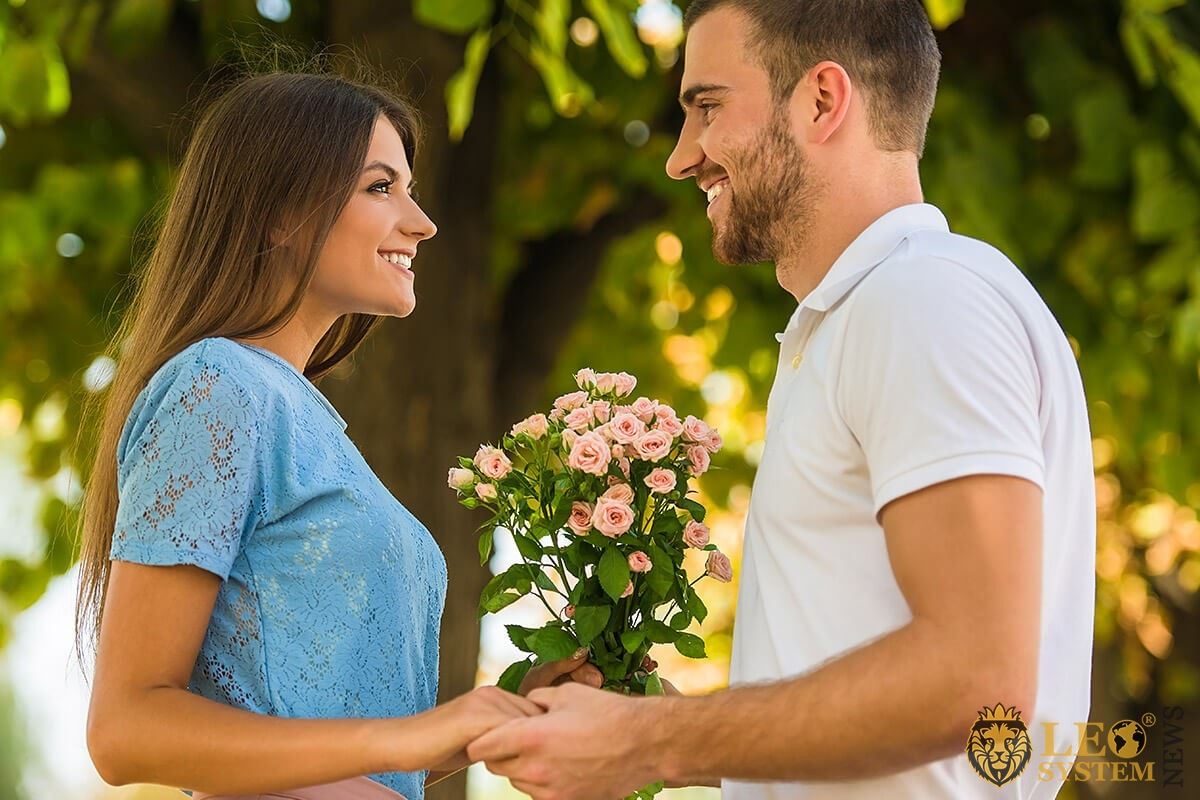 A man gives flowers to a woman and declares his love