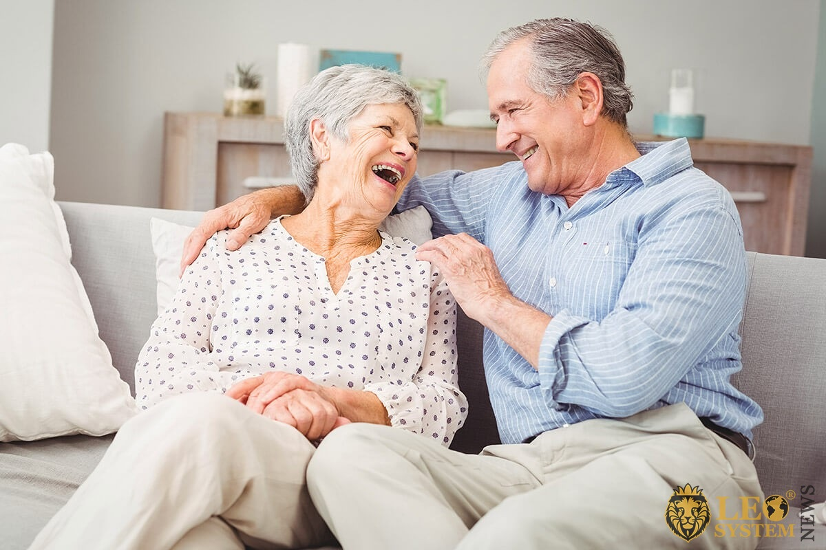 Joyful elderly family talking to each other