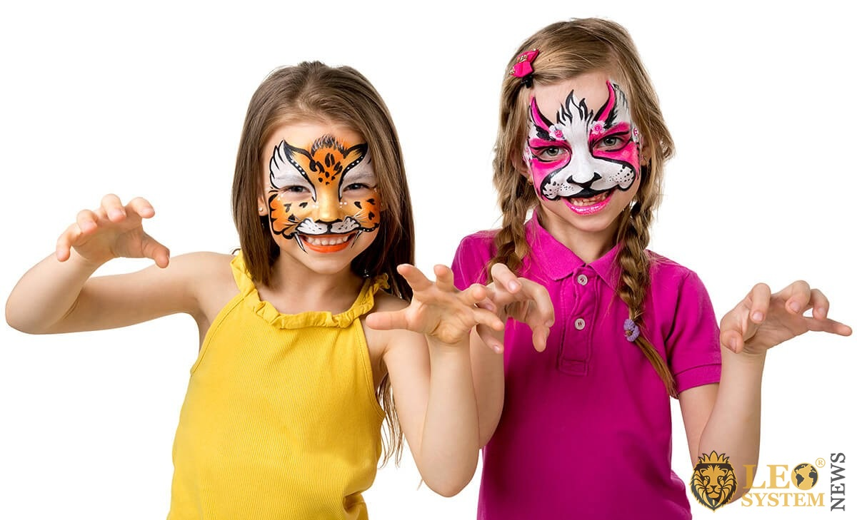 Children play and painted their face with paints