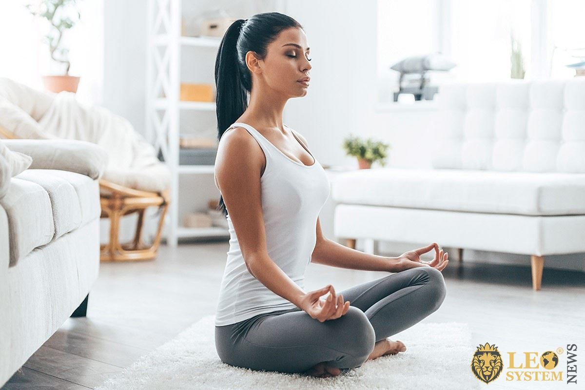 Woman practices yoga for health and youth