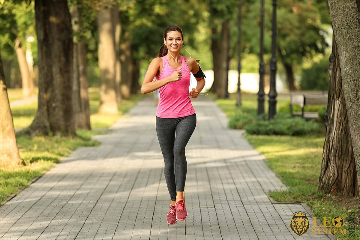 Woman goes in for sports - runs through the forest