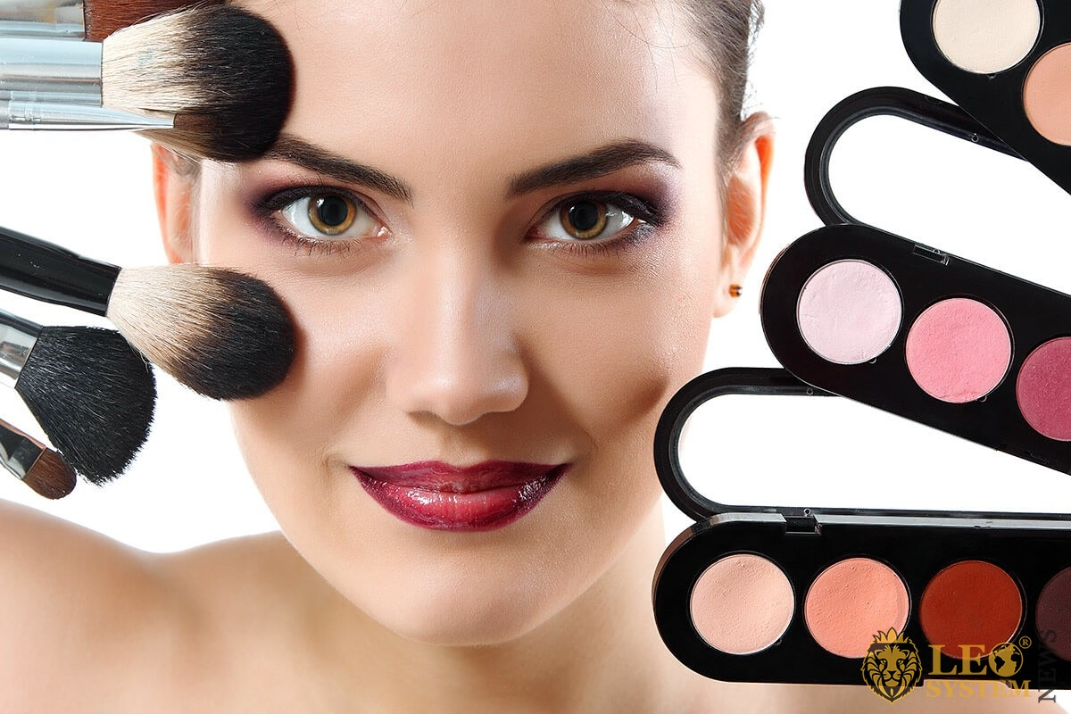 Woman with makeup products