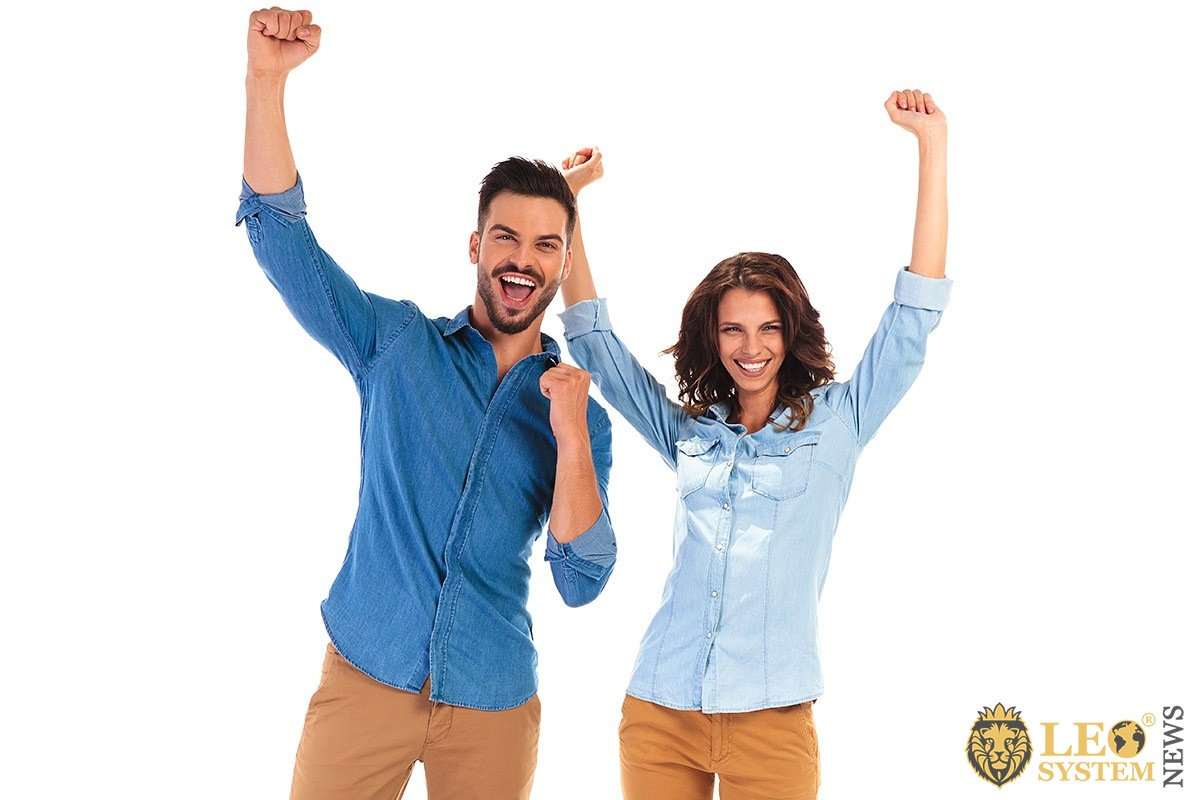 A man and a woman together rejoice in their success