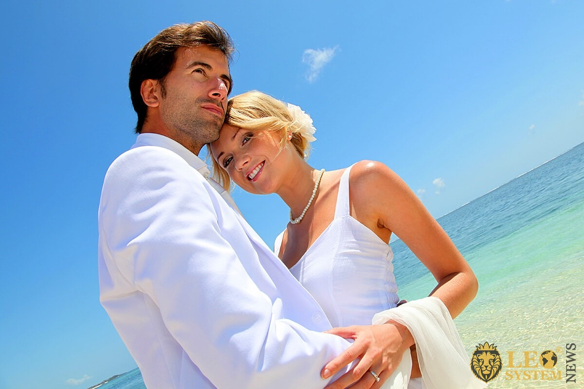 Romantic couple passionately hugging by the sea