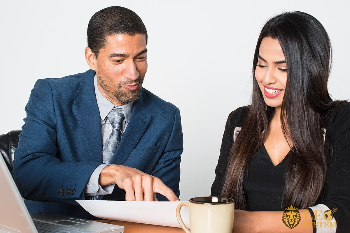 Image of man and woman reading together prenuptial agreement