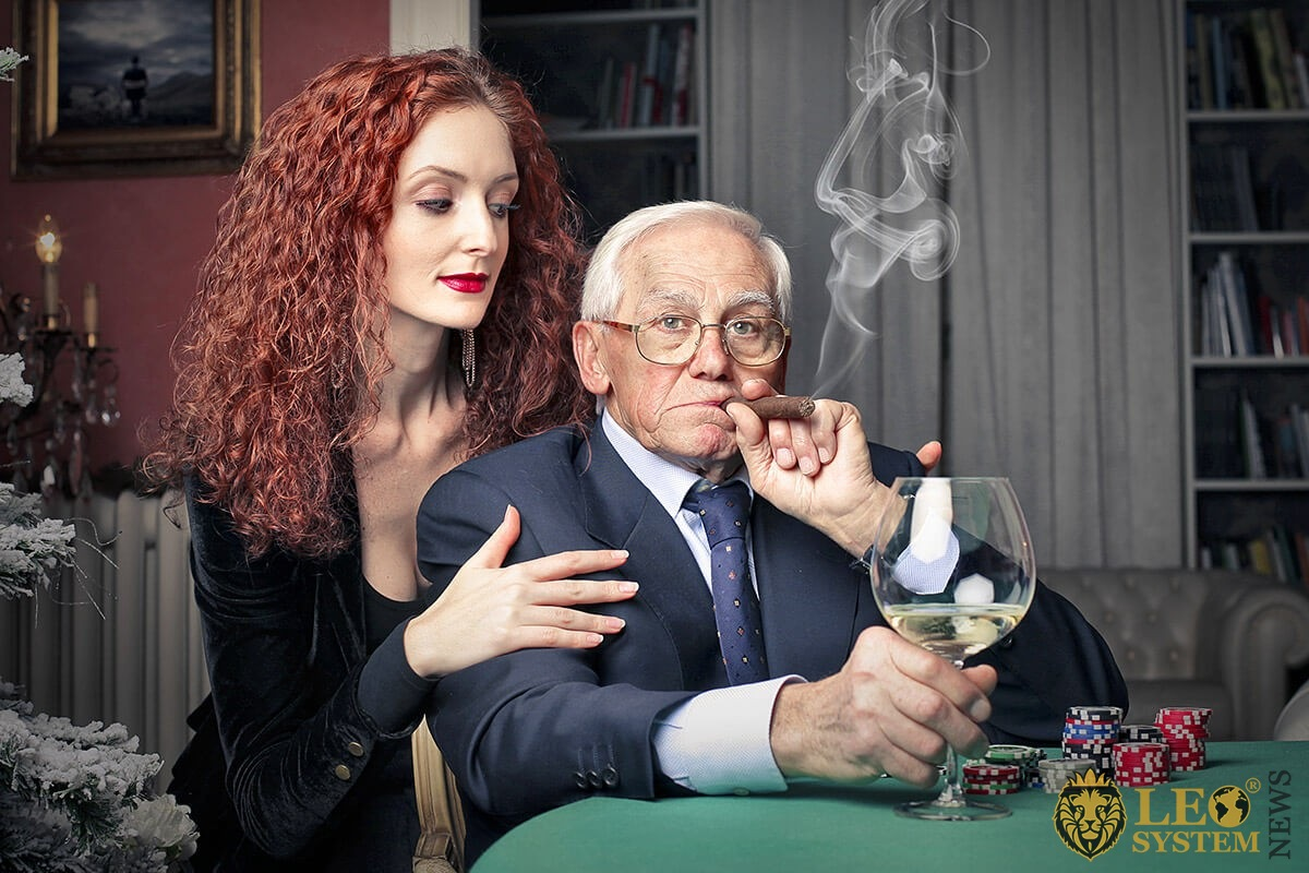 Image of a rich elderly man and his young wife