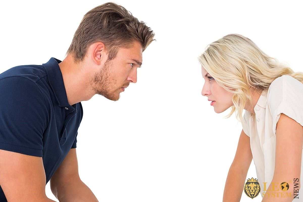 Man and woman look at each other very carefully