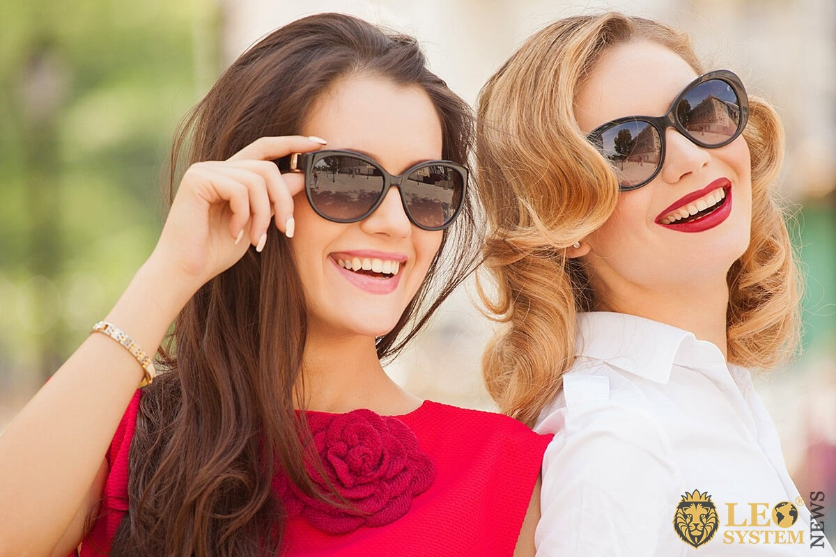 Image of two beautiful women in glasses
