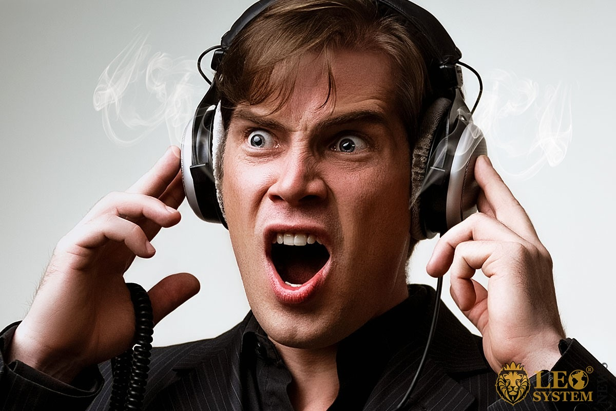 Image of man in headphones in anger and rage