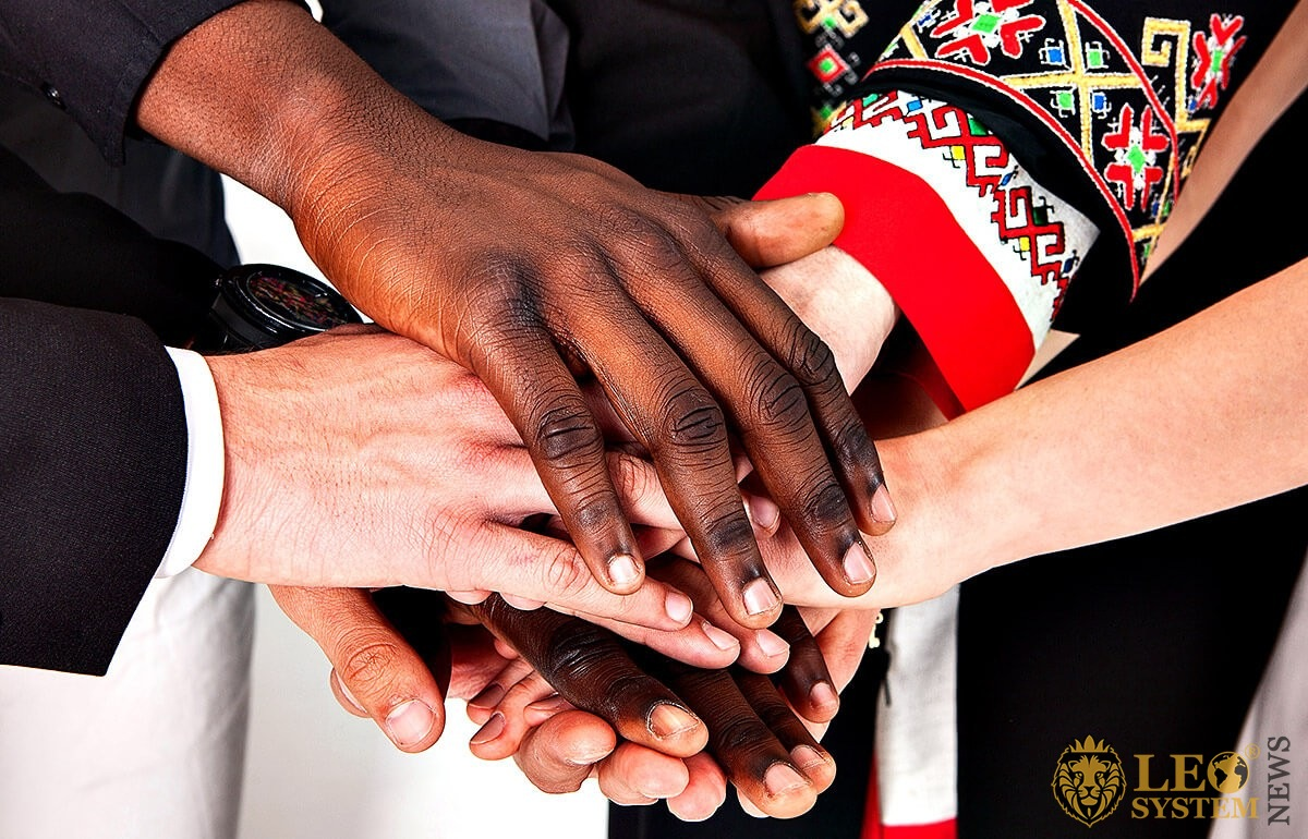Handshake of people of different nationalities
