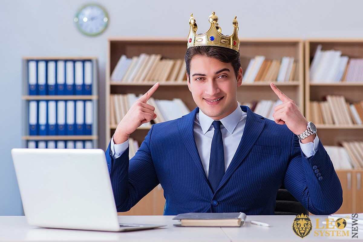 Business man with a crown on his head