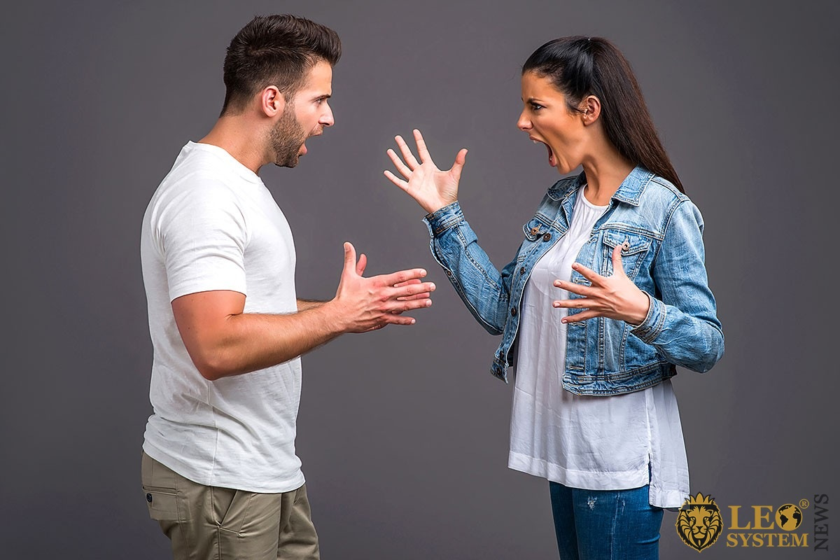 Image of a man and a woman in anger shout at each other