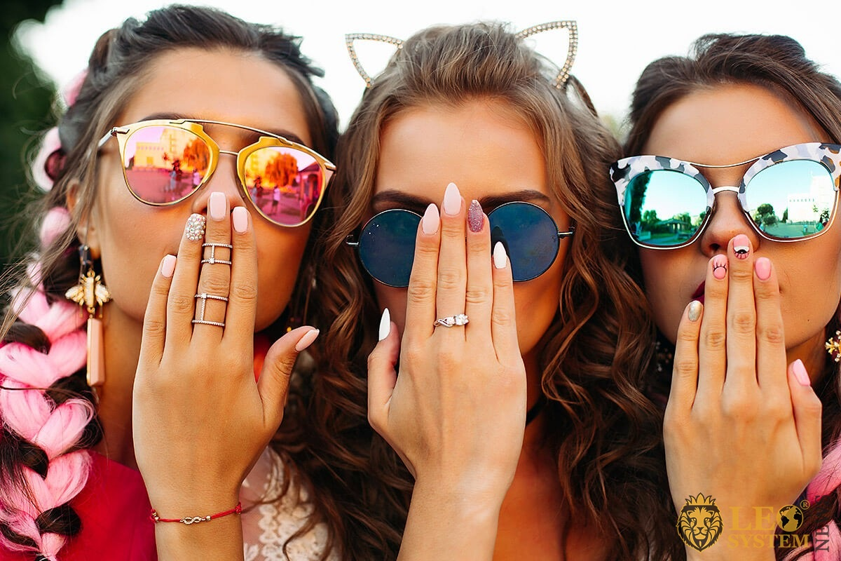 Image of three young girls and their hands with manicures