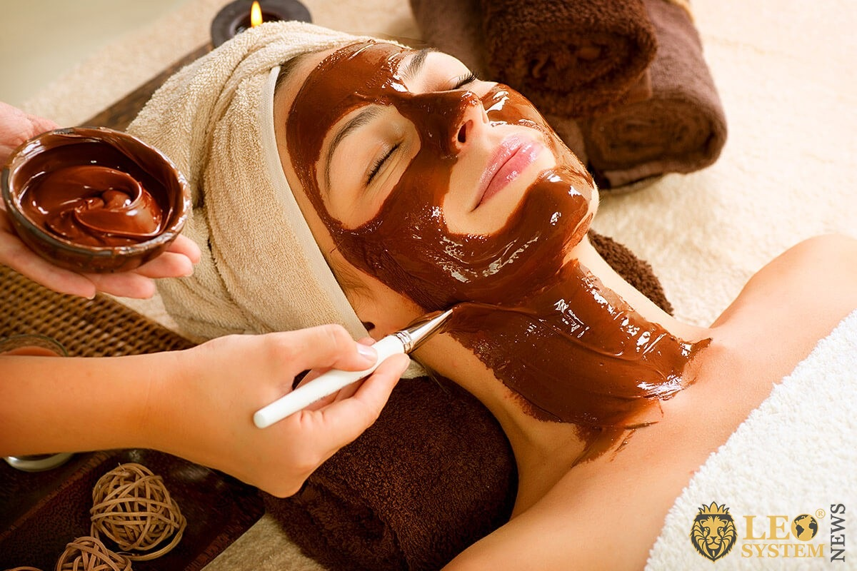 Image of a girl caring for her face and making a mask