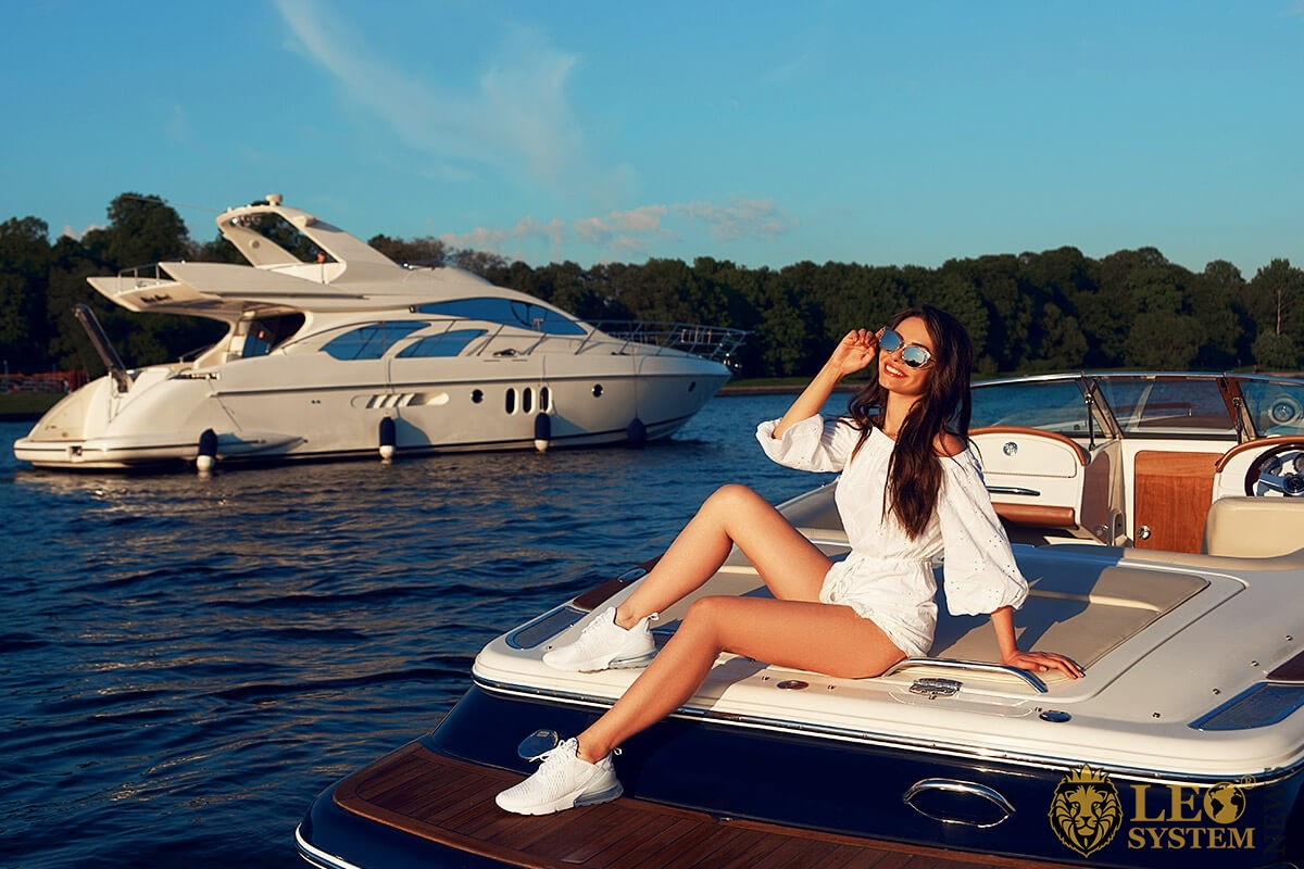 Image of a pretty girl sitting on a yacht