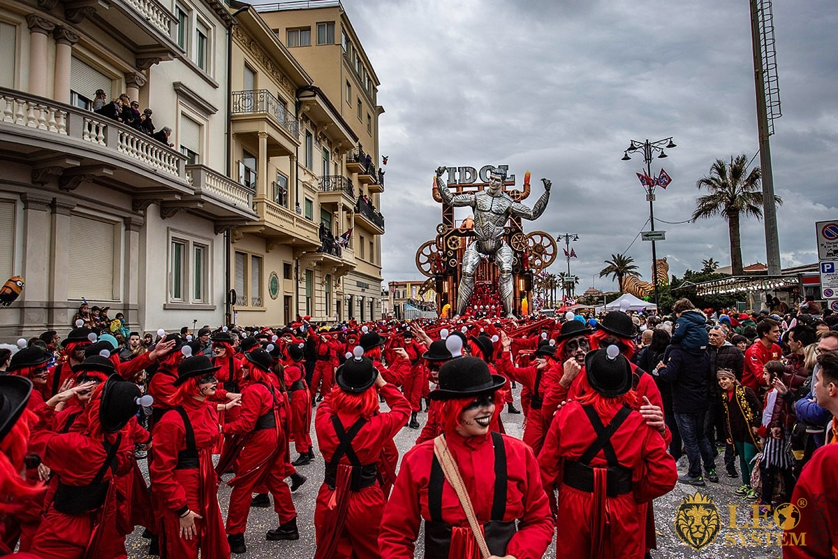 View of the Parade of Carnival floats with dancing people, streets of Viareggio, Italy
