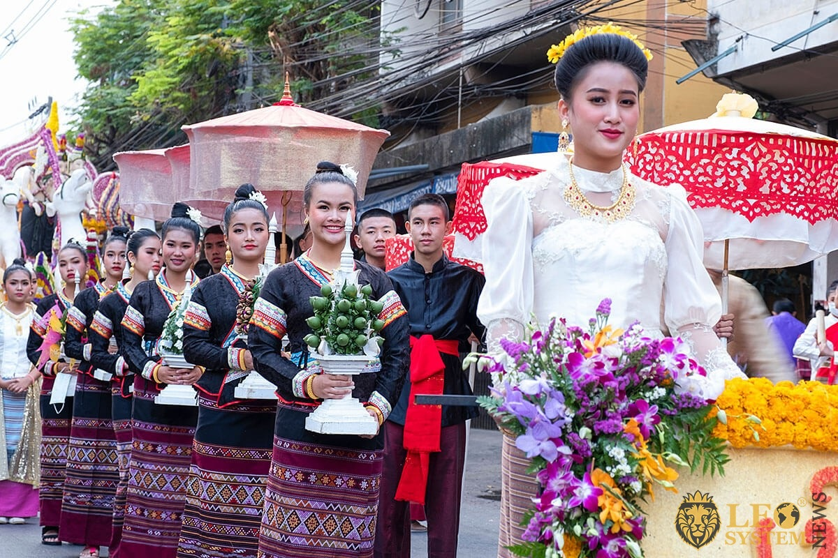 Image of young women with flowers in their hands - Annual Flower Festival Parade 2020, Chiang Mai, Thailand