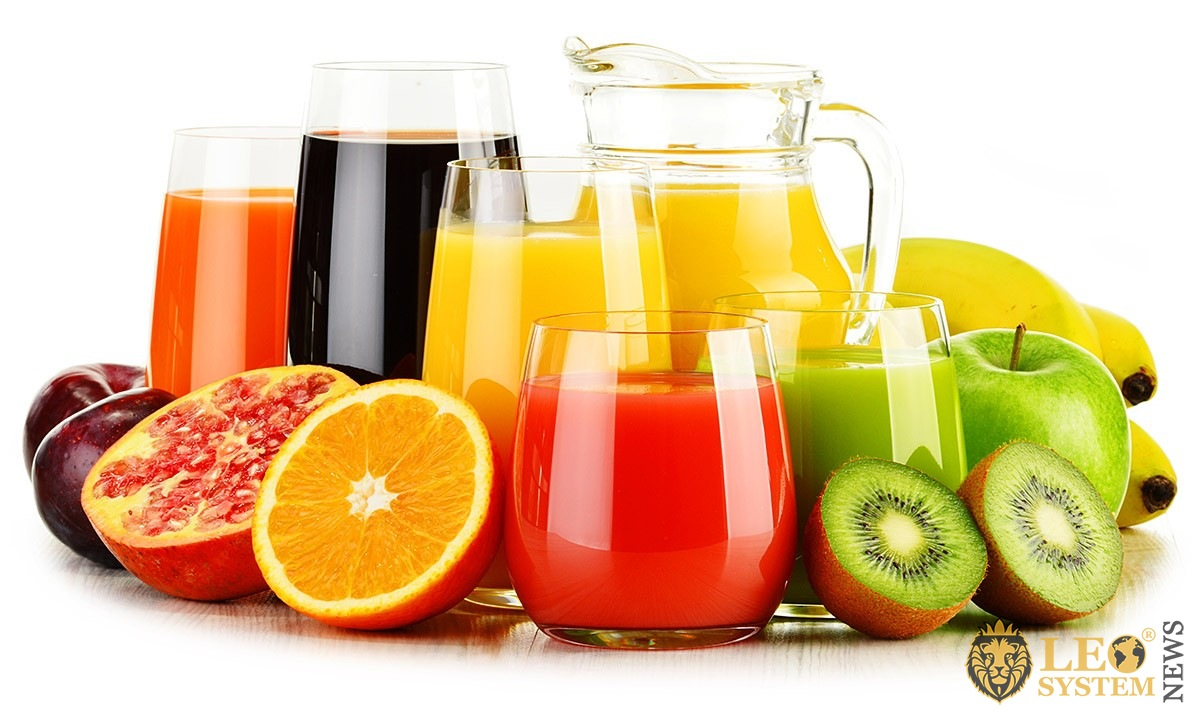 Image of fresh fruits and glasses with freshly squeezed juice
