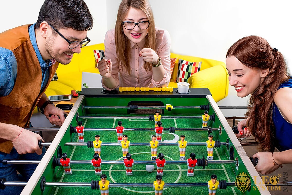 Girl and guy playing table football