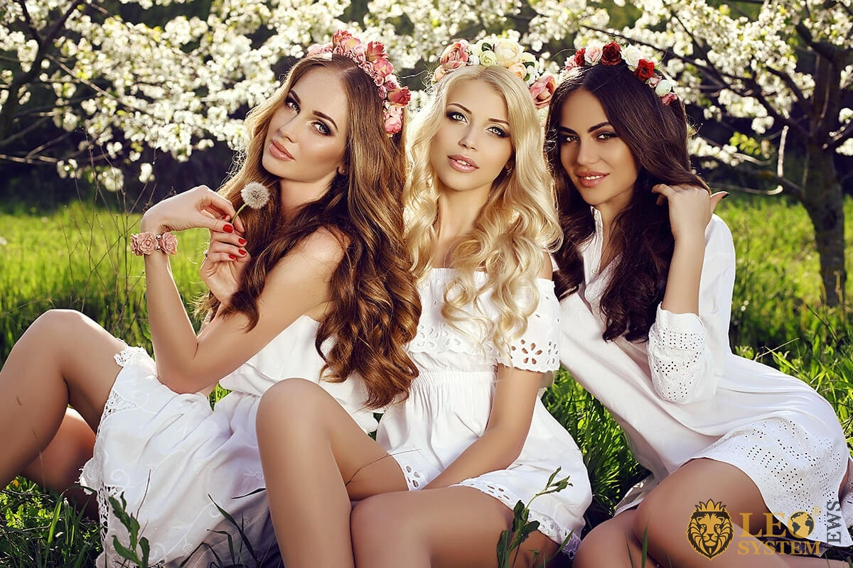Image of beautiful girls with flowers in their hair