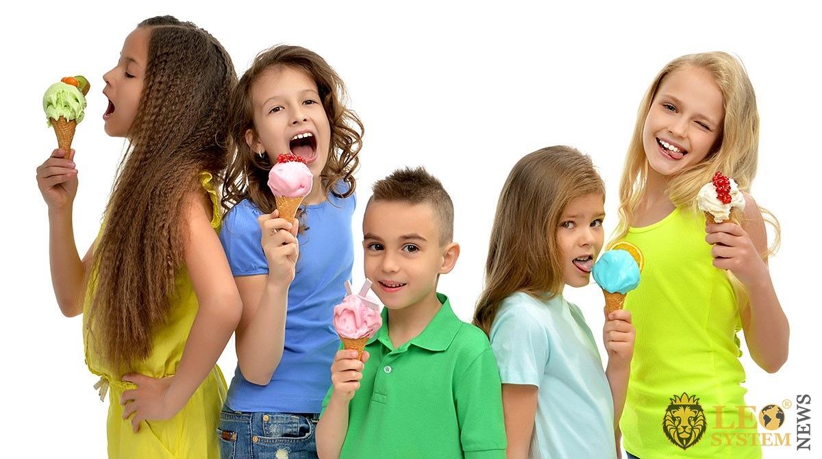 Joyful kids eating ice cream