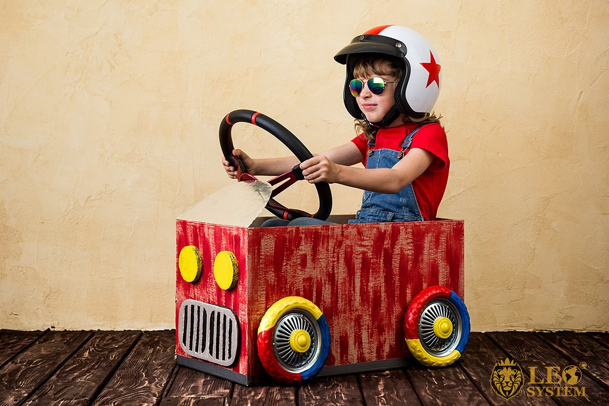 The child independently plays with the children's car