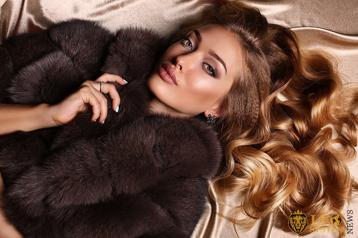 Beautiful stately woman in an expensive fur coat