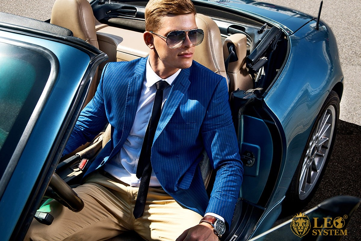Image of a rich man on an expensive car