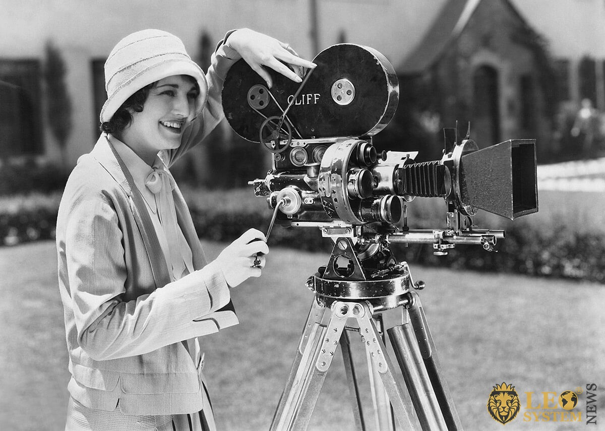 Historical image of a woman with an old camera