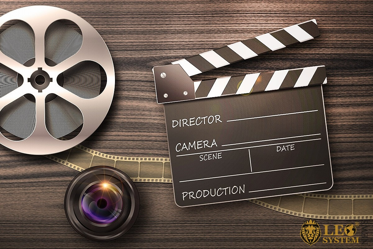 Image of reel with film and clapperboard