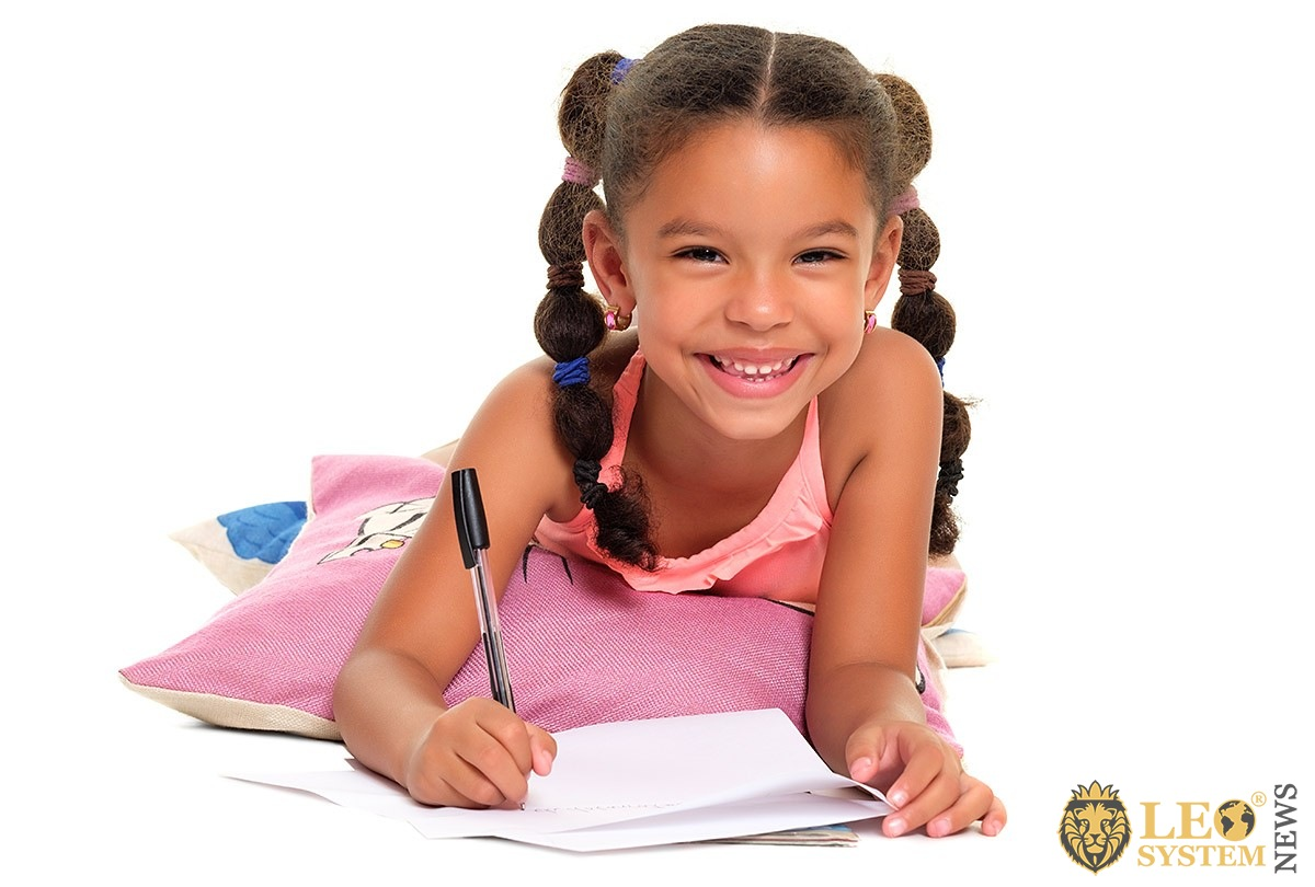 Image of a girl with a notebook and pen
