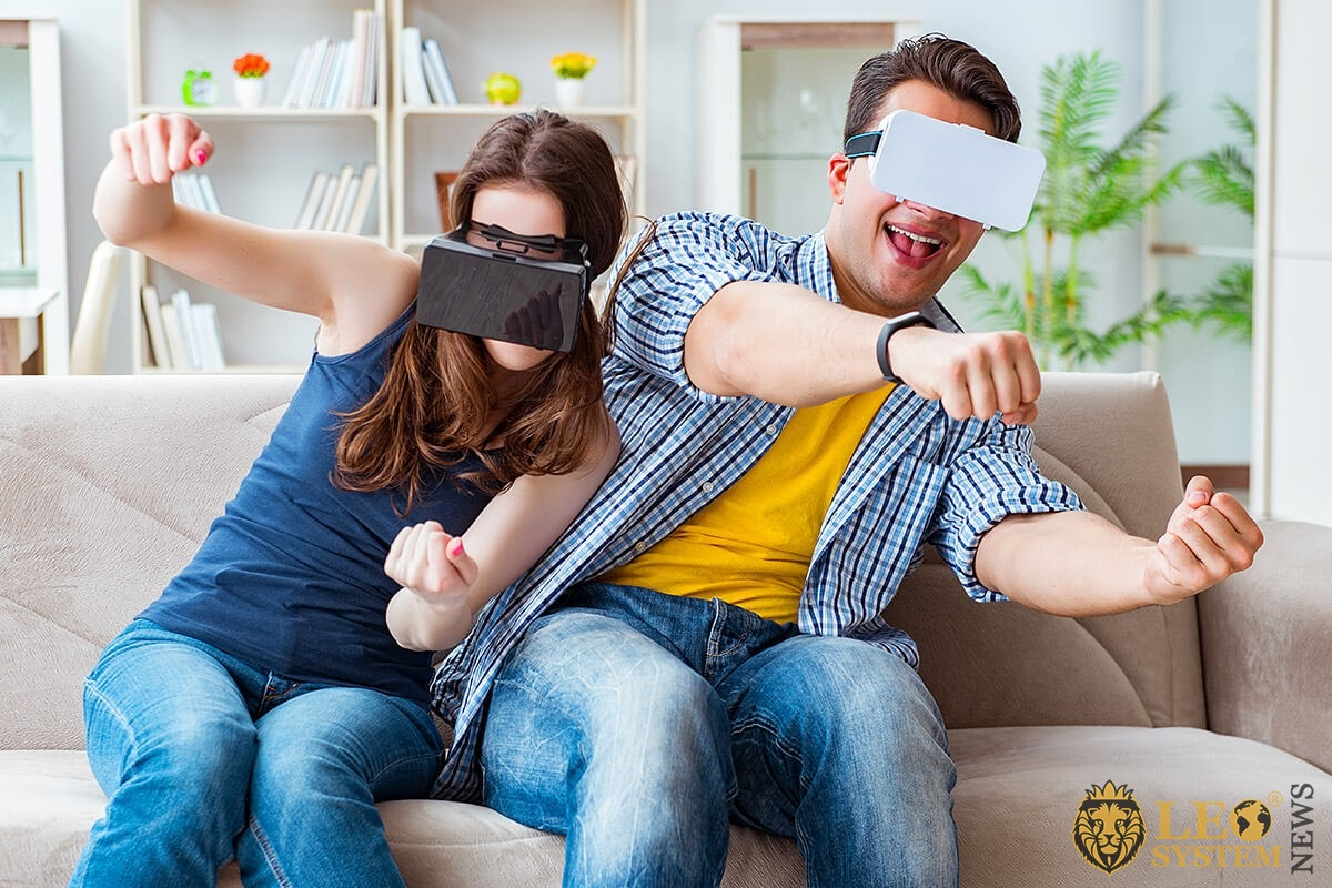 Man and woman in virtual reality glasses