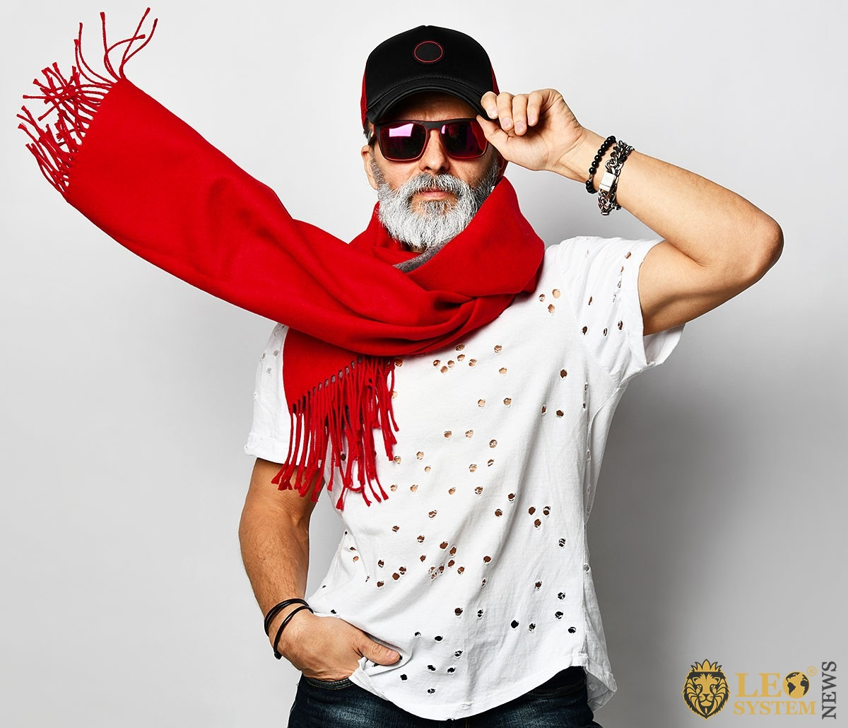 Man with glasses, a cap and a red scarf