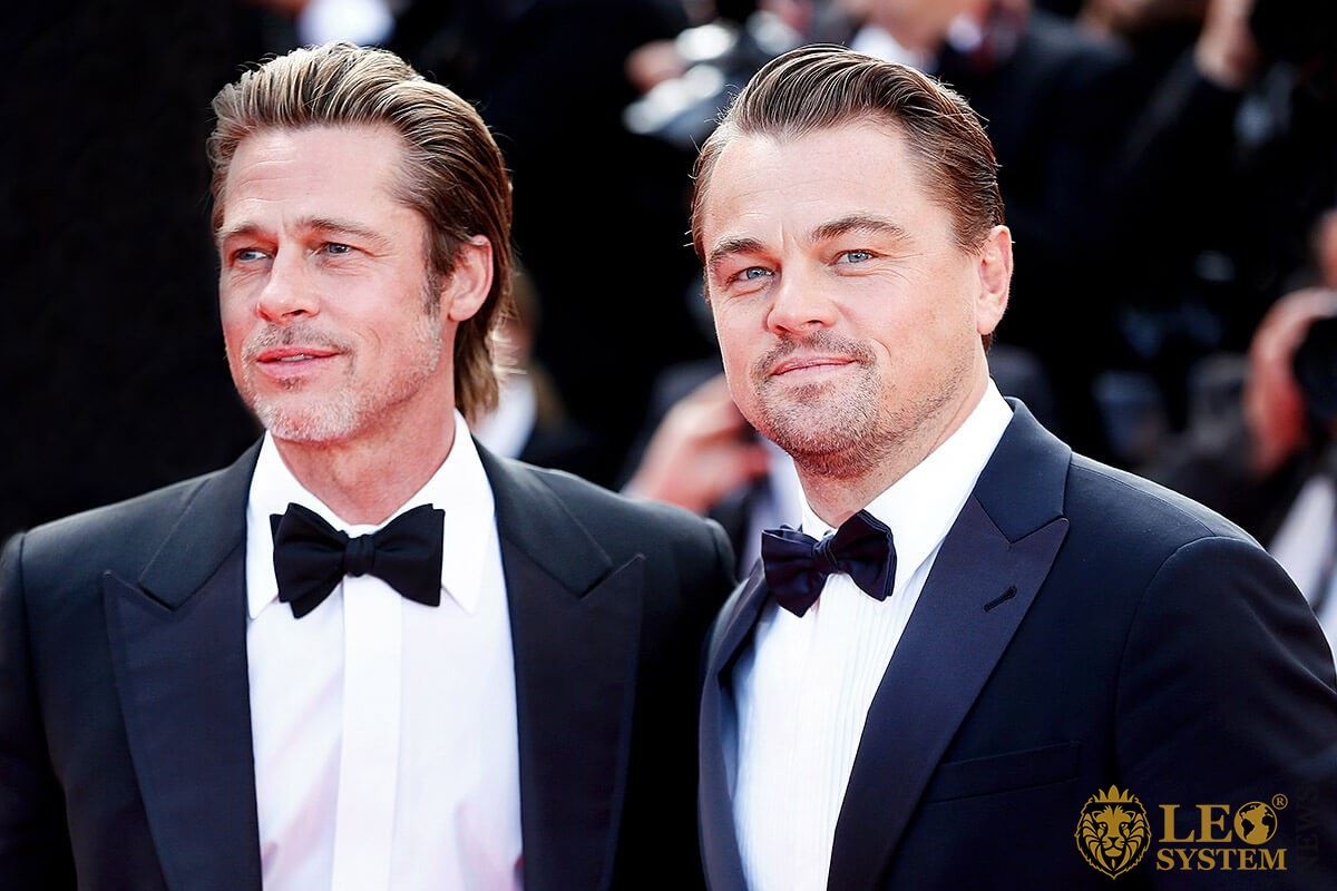 Image of smiling Brad Pitt and Leonardo DiCaprio