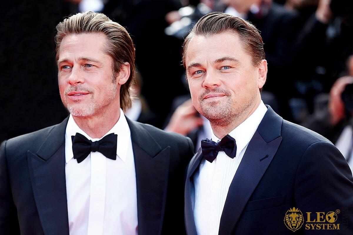 Image of smiling Brad Pitt and Leonardo DiCaprio
