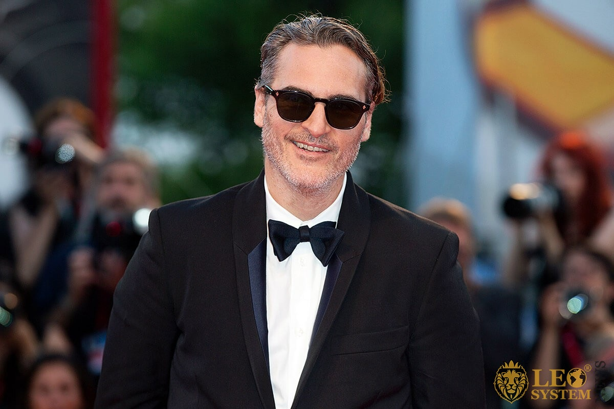 Image of Joaquin Phoenix with a smile on his face