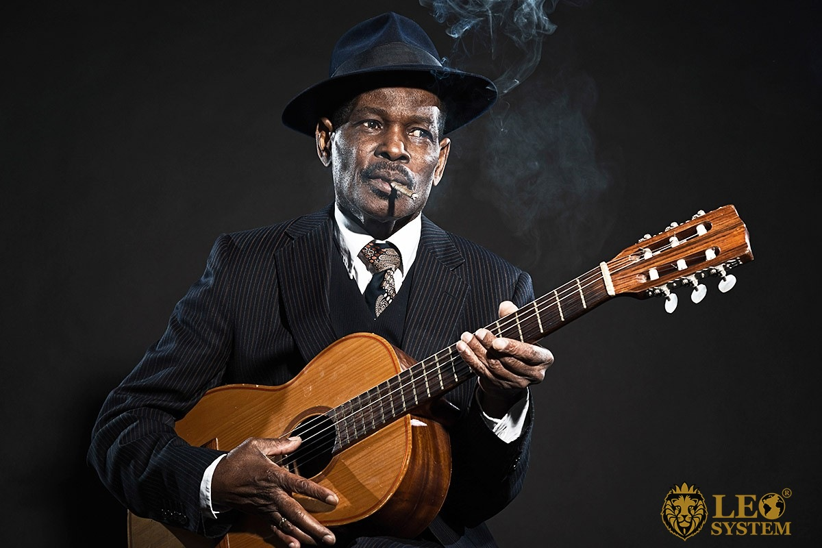 Image of a black man with a guitar