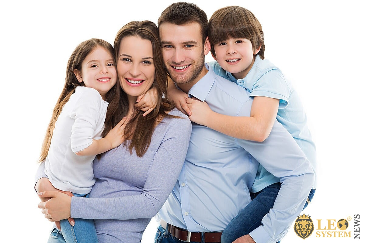 Image of a family and their children